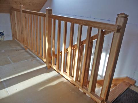 Un escalier quart tournant : garde-corps, vue d'ensemble